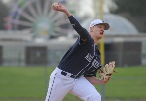 Ryan Fitton (12) of the Staples Wreckers delivers a pitch during a game against the Trumbull Eagles at Trumbull High School on April 11, 2016 in Trumbull, Connecticut.
